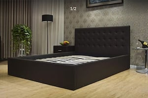 Black wooden bed frame with mattress