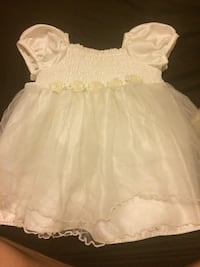 girl's white sleeveless dress