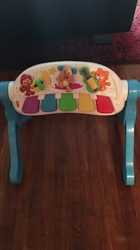 multicolored Fisher-Price plastic musical toy