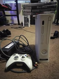 white Xbox 360 console with controllers 2286 mi