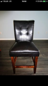 Brown wooden framed genuine leather padded chair