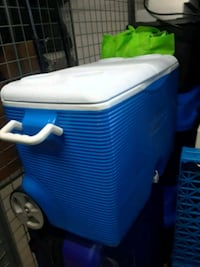 Cooler with wheels and handle