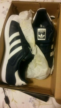 pair of black-and-white Adidas sneakers Grand Island, 68801