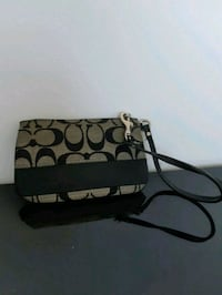 brown and black monogrammed Coach wristlet Vancouver, V5X 1N4