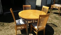 round brown wooden table with four chairs dining set Milton, 19968
