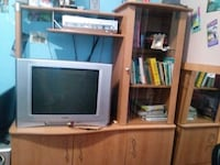gray CRT television with brown wooden TV hutch Montréal, H4L 3G4