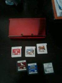 red Nintendo DS with game cartridges Montréal, H1G 2J2