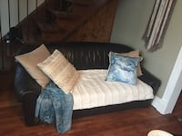 Black leather couch Gatineau, J8X 1T6