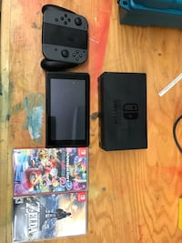 black Nintendo 3DS with game cases