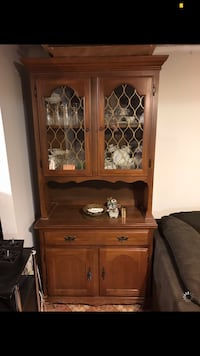 brown wooden framed glass display cabinet Montreal, H1Z 4C4