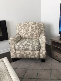 brown and gray floral sofa chair