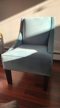 gray fabric padded brown wooden armchair