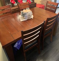 brown wooden dining table with chairs Mississauga, L5B
