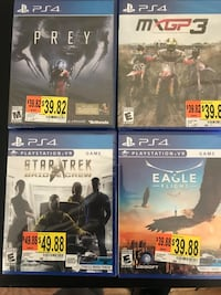 four assorted Sony PS3 game cases