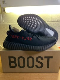 pair of black Adidas Yeezy Boost 350 V2 on box Houston, 77093