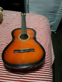 red and black acoustic guitar 784 km