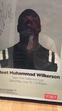 Meet muhammad wilkerson signed poster with rectangular black wooden framed