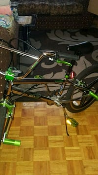 black and green BMX bike