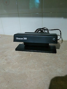 Counterfeit currency detector / black light