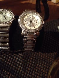 two round silver analog watches with link bracelets Kelowna, V1Y 8S6