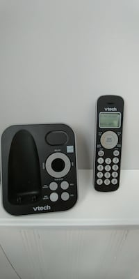 black and gray Vtech wireless home phone