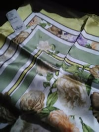 white and green floral textile