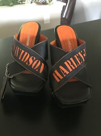 Ladies Harley sandals , new in box, size 6.5, black and orange. Frederick, 21701