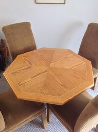 Octagonal brown wooden table with four brown fabric-padded chairs New Westminster, V3M 6E1