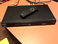 black Philips DVD player with remote control