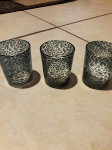 three grey-and-green leopard print glass cups