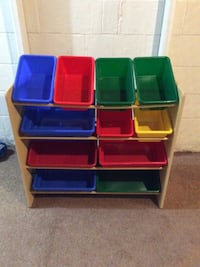 brown wooden framed assorted colors of toy organizers