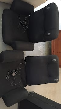Two black, adjustable gaming chairs