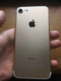 Gold iPhone 7 in great condition, home button does not work but the add on home button works Annapolis, 21032