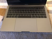 """MCbook Pro 13"""" Touch Bar and ID Calgary"""