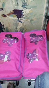 two pink and black and purple Minnie Mouse bags Midvale, 84047