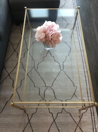 gold trim glass coffee table
