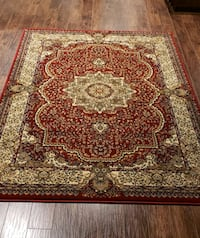 Maroon and cream color 5'by8' area rug
