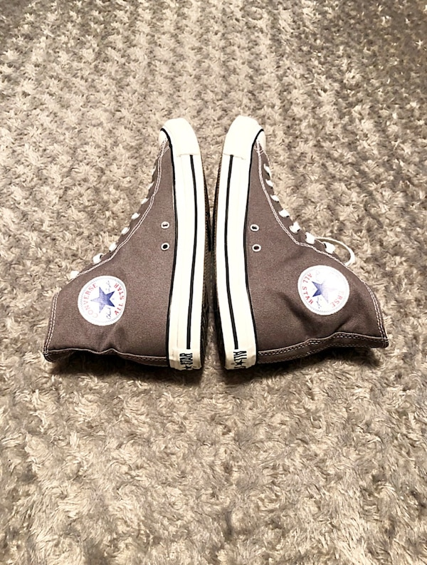 Converse All-Stars paid $56 size 10 men size 12 women Classic Chuck Taylor hi-top. Color grey. Boasts a durable canvas upper, cotton laces, a padded c22fc979-2bc9-47bb-8bea-8379ff7c1f3e
