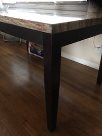 Granite dining table with 4 chairs.