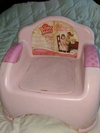 baby's pink and white plastic highchair Apple Valley
