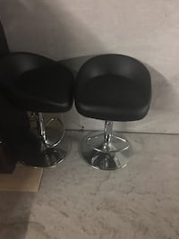 Two brand new counter stools