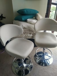 two white leather padded rolling chairs Mississauga, L4Z 1W3