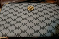 white and gray Michael Kors leather wristlet Lubbock, 79412