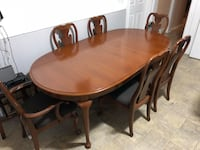 oval brown wooden table with six chairs dining set Totowa, 07512