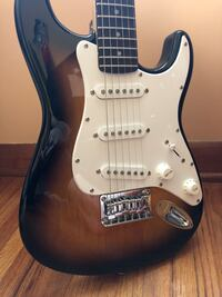 Brown and white electric guitar Evansville, 47720