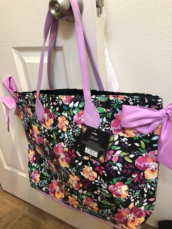 black, pink, and green floral tote bag