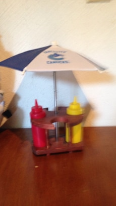 white and pink miniature umbrella; 2 red-and-yellow plastic bottles