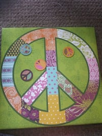 pink, brown, and green floral peace sign painting