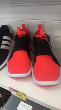 pair of red-and-black Adidas sneakers Houston, 77081