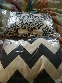 two white and black throw pillows with clear plastic pack Sheridan, 60551